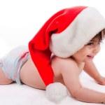 Santa baby trying to crawl — Stock Photo #1244393