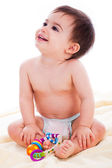 Baby sitting with toys and smile — Stock Photo