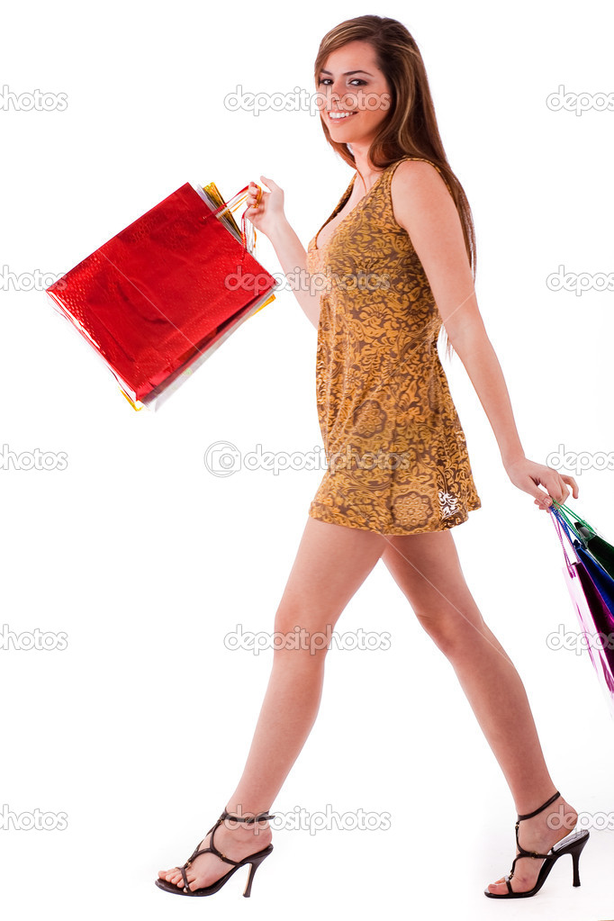 Young fashion model at shopping on a isolated background   #1243996