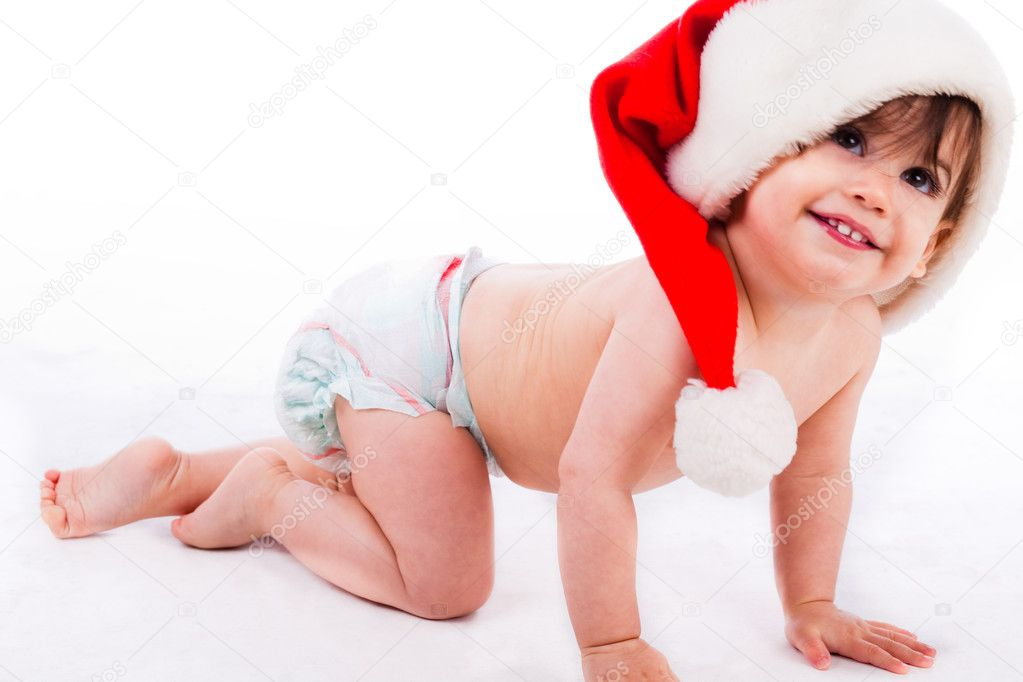 Baby crawling with santa cap in a white background — Stock Photo #1244374