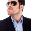 Young man with his sunglasses — Stock Photo
