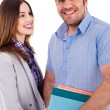 Couple with notebook - Stock Photo
