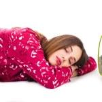 Women sleeping with the alarm — Stock Photo