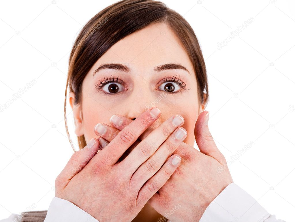 Closeup of young women covering her mouth with both hands on a white isolated background — Stock Photo #1301400