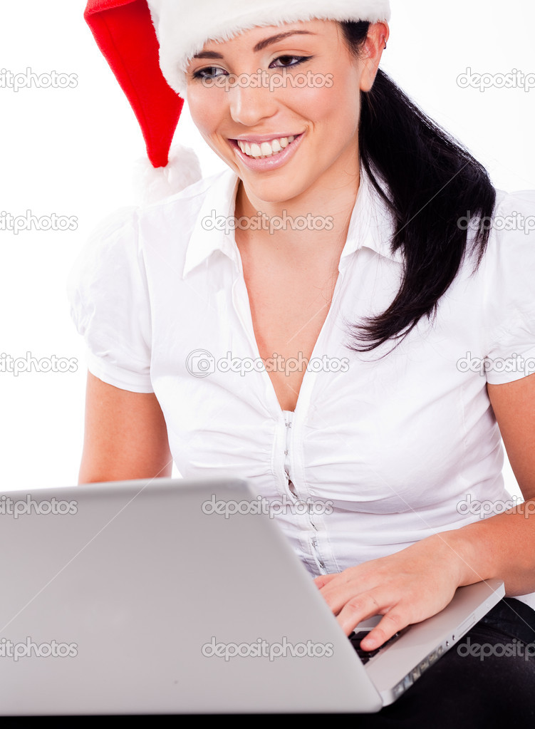 Young santa girl browsing the net on a white isolated background — Stock Photo #1316831