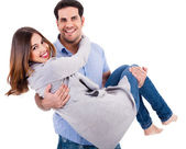 Cheerful young couple piggybacking — Stock Photo