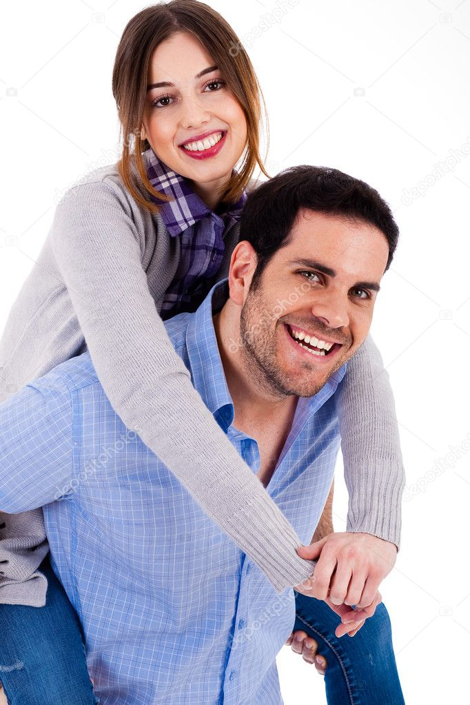 Cheerful young couple piggybacking on a white background — Stock Photo #1329868