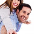 Man giving piggyback ride to his lover — Stock Photo