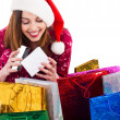 Santa girl opening the gift box — Stock Photo
