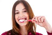 Women brushing her teeth — Stock Photo