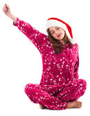 Santa girl stretching her hand — Stock Photo