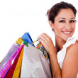 Pretty young women smiling with bags — Stock Photo