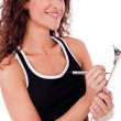 Fitness woman writing on a clip board — Stock Photo