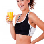Fitness girl having fresh juice in hand — Stock Photo