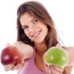 menina dando maçã em ambas as mãos — Foto Stock