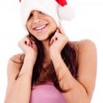 Women embarrassing wearing santa cap — Stock Photo