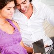 Happy young couple looking at cds — Stock Photo