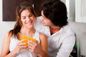 Youn couple cheers their drink — Stock Photo