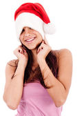 Women embarrassing wearing santa cap — Stock Photo