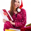 Santa girl holding a christmas card — Stock Photo