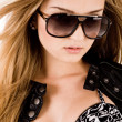 Stock Photo: Young brunette model with sunglasses