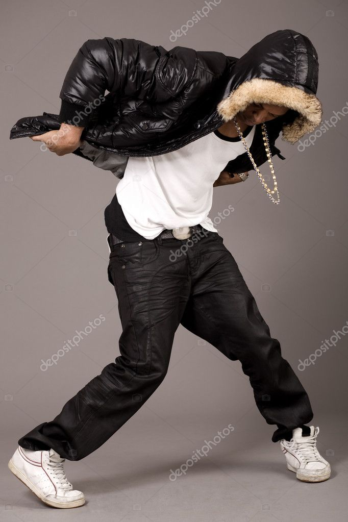 Man performs hip pop steps on grey background — Stock Photo #1553380