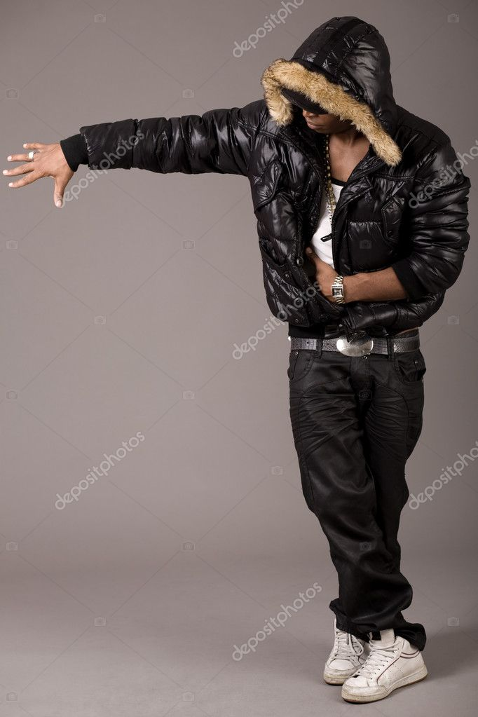 Black african rap performer on grey background  Stock Photo #1553604