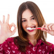 Women brushing her teeth — Stock Photo