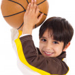 Little kid while throwing the ball — Stock Photo