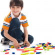 Adorable boy joining the blocks — Stock Photo