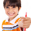 Boy showing the toothbrush — Stock Photo
