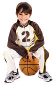 Kid stylishly sitting on the ball — Stock Photo