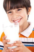 Happy kid drinking glass of milk — Stock Photo