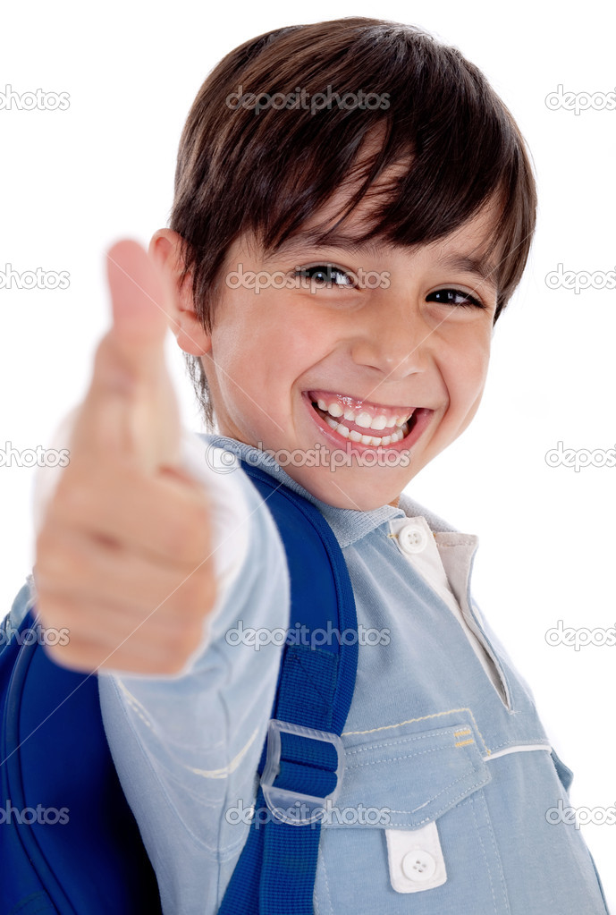 Smiling kinder garden boy gives thumbs up on isolated white background  Stock Photo #1960611