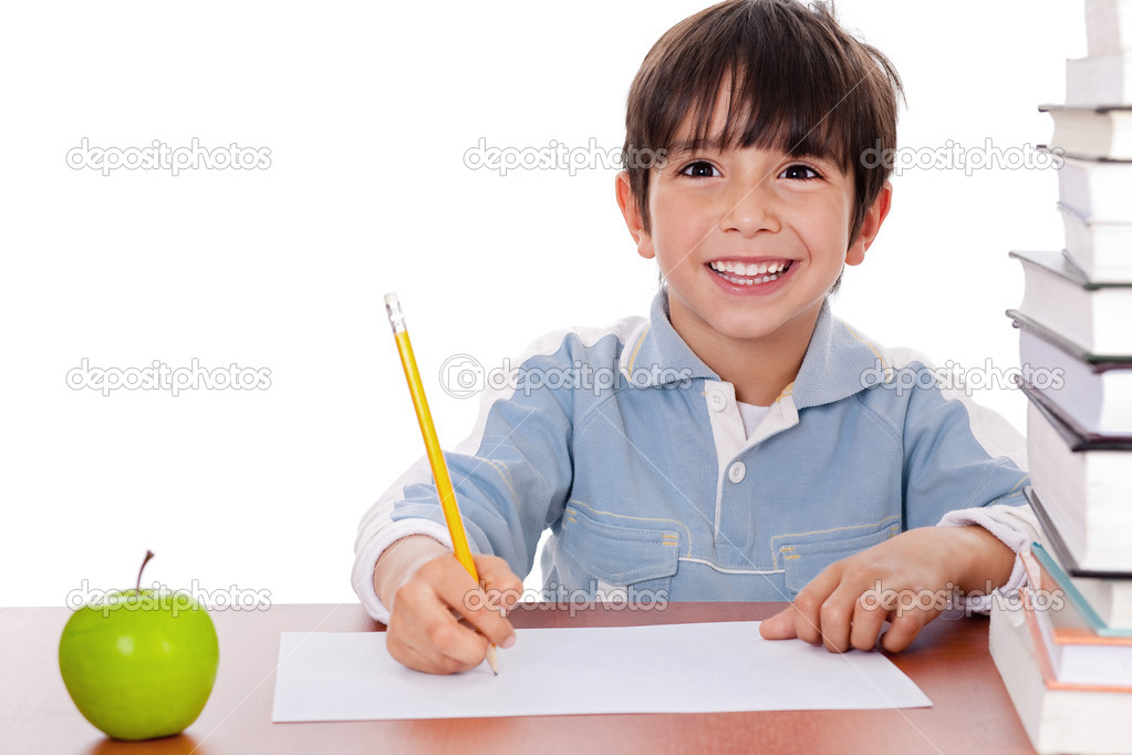 School boy doing his homework with an apple beside him on white background — 图库照片 #1965403