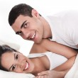 Young couple having fun in bed — Stock Photo