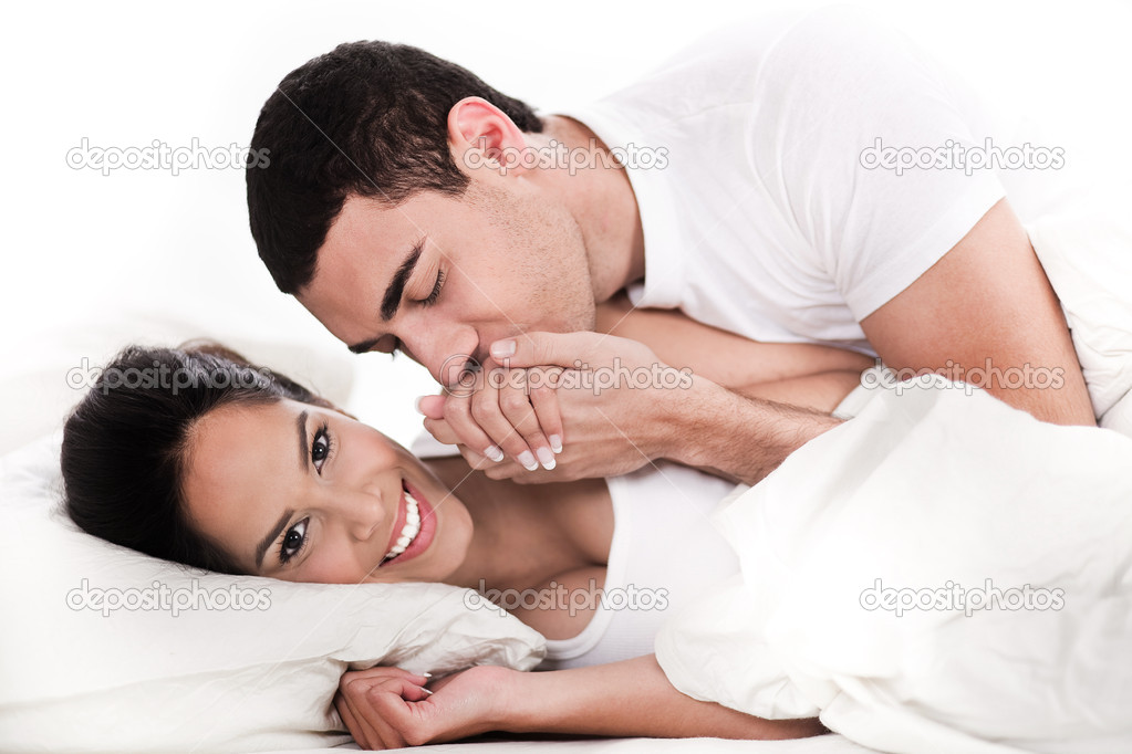 Intimate young couple in bed over white background — Stock Photo #2007475