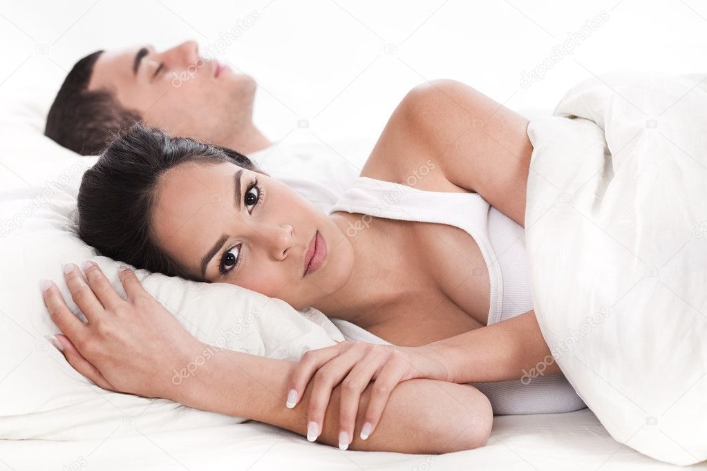 Couple in bed, men sleeping and woman lying sleepless in white background — Stock Photo #2007608