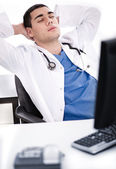 Male doctor relaxing at his cabin — Stock Photo
