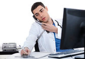 Doctor busy during duty time — Stock Photo