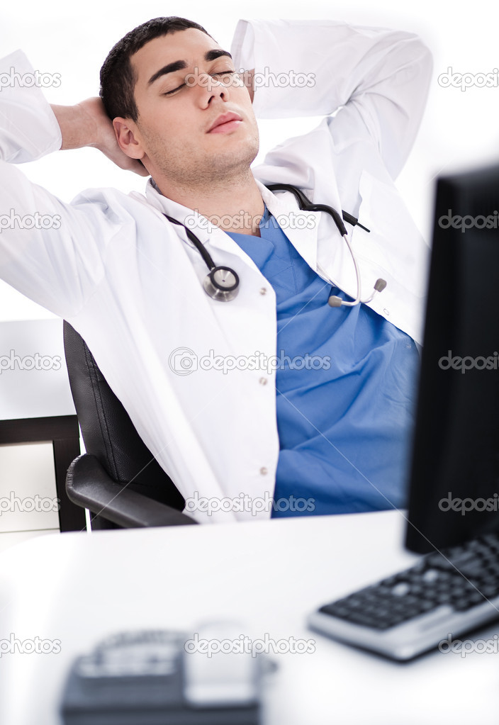 Young male doctor relaxing at his cabin in the hospital — Stock Photo #2122166