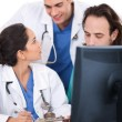 Royalty-Free Stock Photo: Young doctors team discussing