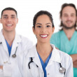 Ethnic doctor with colleagues — Stock Photo #2181160