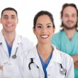 Ethnic doctor with colleagues — Stock Photo