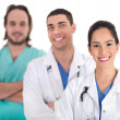 Portrait of three doctors in a hospital — Stock Photo