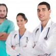 Group of doctors smiling at the camera — Stock Photo