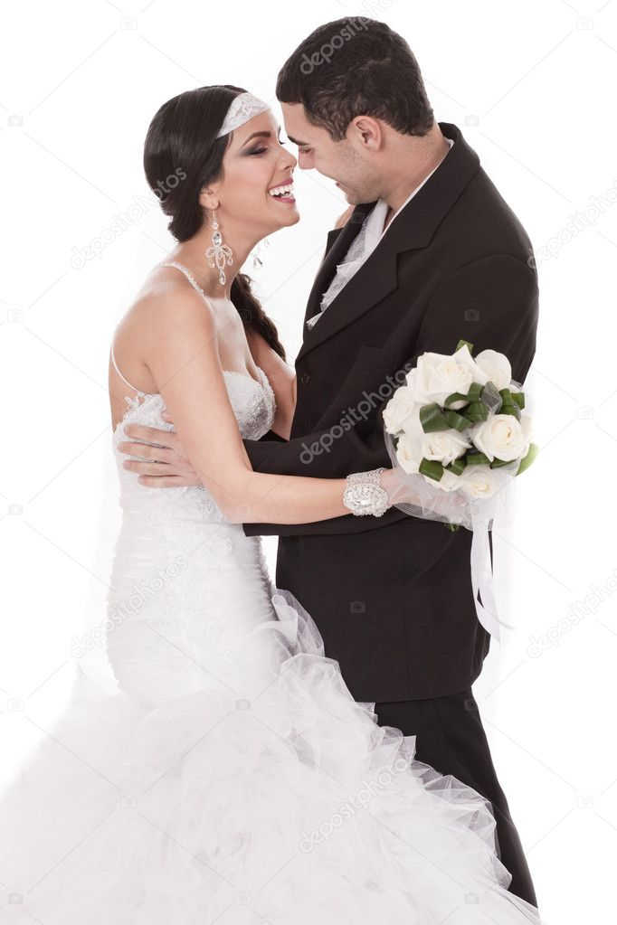 Happy bride and groom on their wedding day over white background — Stock Photo #2180899