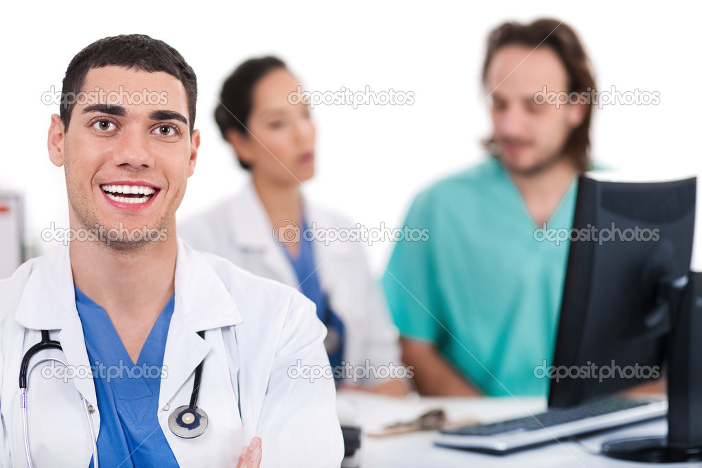 Happy young doctor in focus, two others in out of focus in white background — Stock Photo #2181107