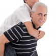 Grandfather piggybacking his grandson — Stock Photo #2213474