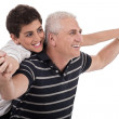 Piggyback ride given by grandfather — Stock Photo #2213529